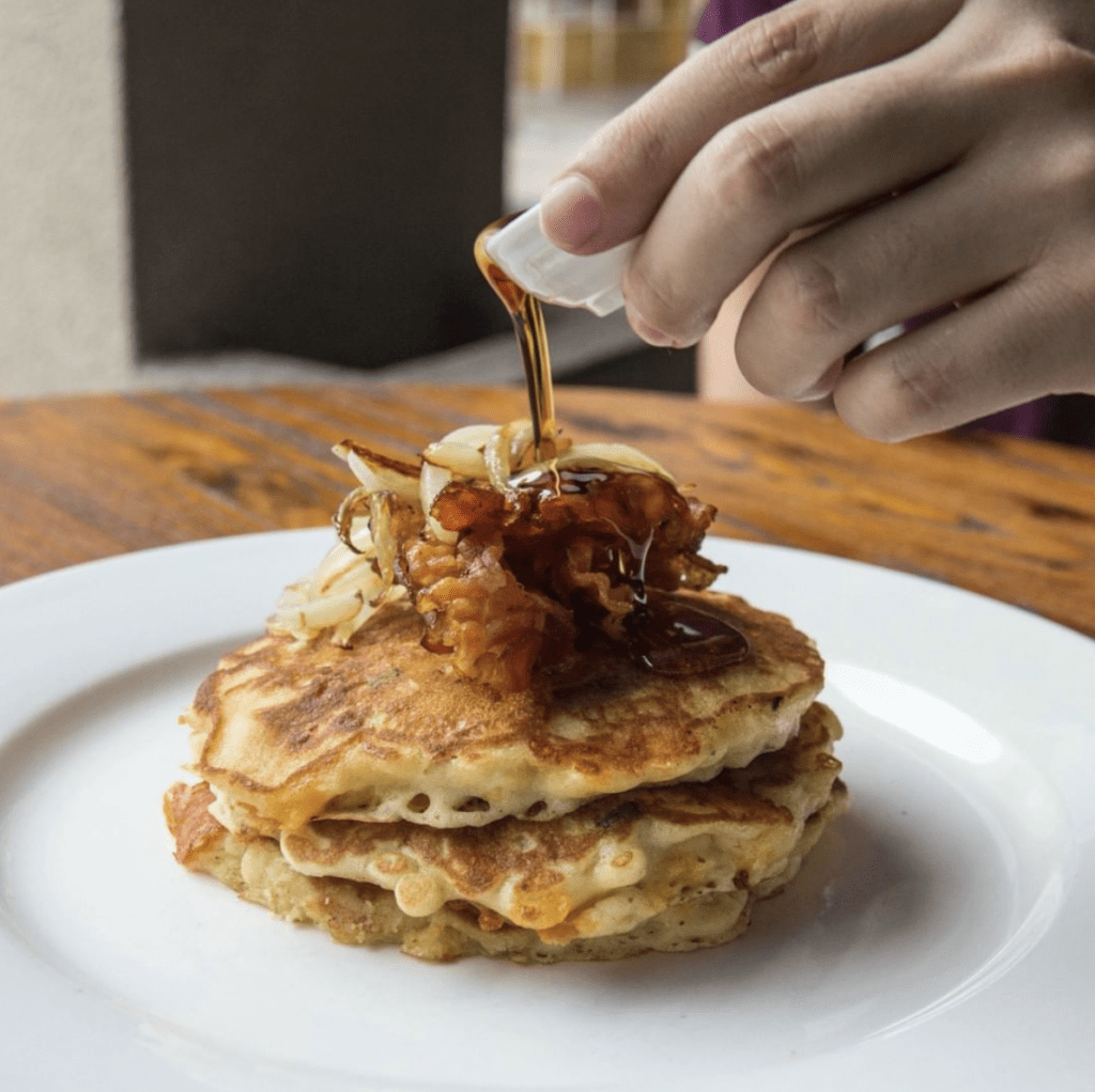 four bistro brunch table showing pancakes on table