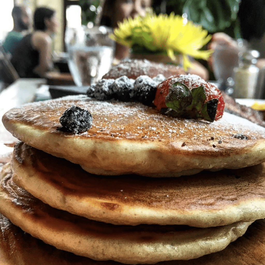 Las Clementinas pancake stack with berries brunch menu