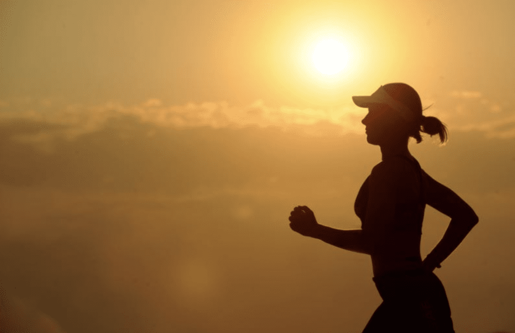 woman-running-with-sunset-behind