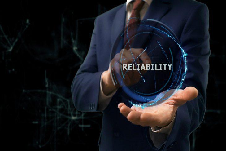 man-holding-reliability-plaque