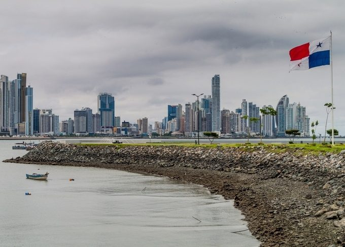 panama flag with view of city in the background