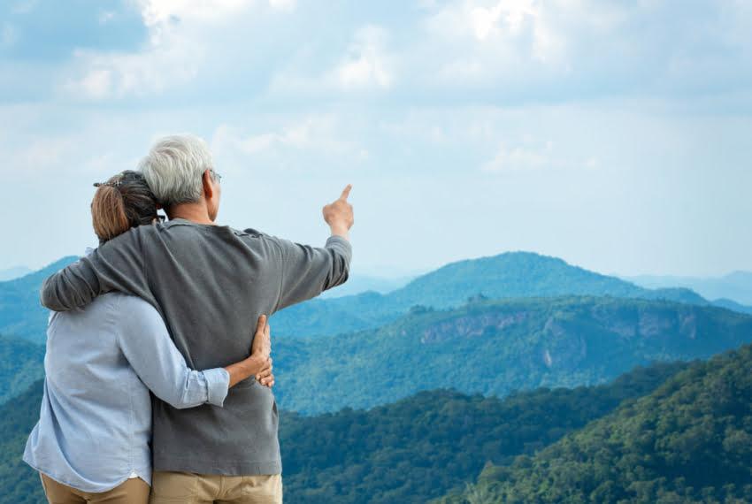 Asian,Lifestyle,Senior,Couple,Hug,And,Pointing,The,Mountain,Nature.